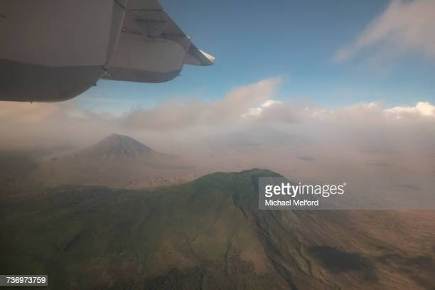 A jet in flight above the volcanoes of Tanzania.