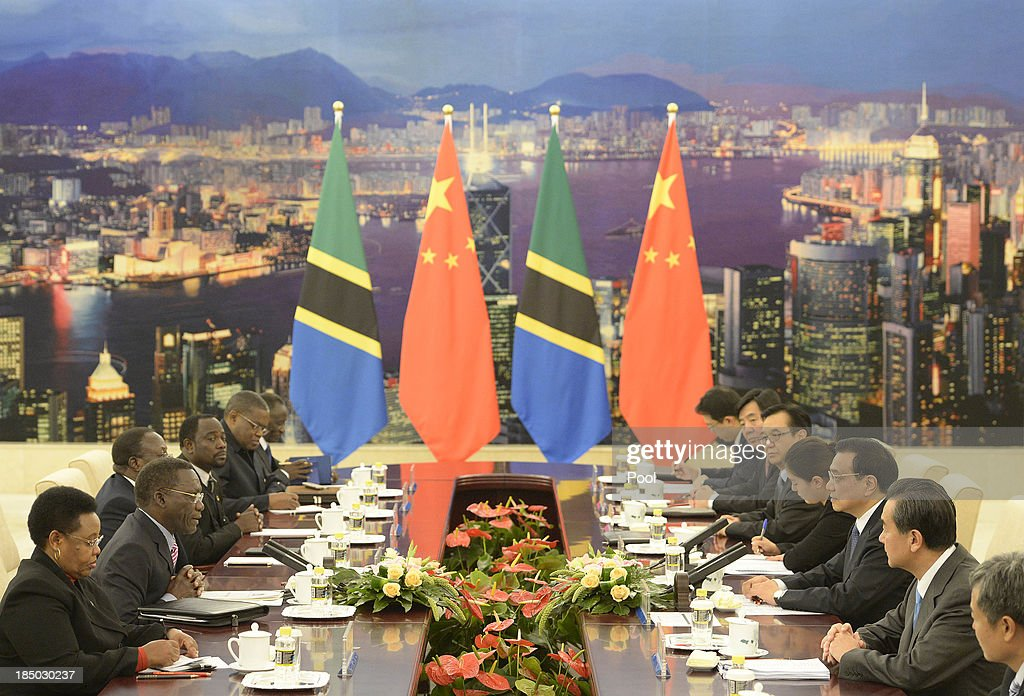 Tanzanian Prime Minister Mizengo Pinda (2L) speaks with Chinese Premier Li Keqiang (3R) during a meeting at the Great Hall of the People on October 17, 2013 in Beijing, China. The two leaders met to discuss China-Tanzania relations.