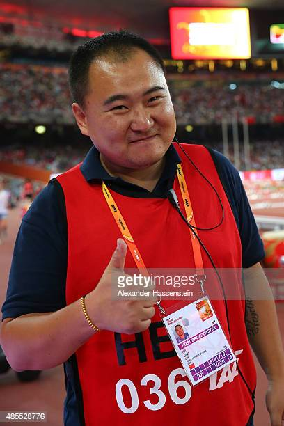 Tao Song of CCTV the segway driver who accidentally collided with Gold medalist Usain Bolt of Jamaica following the Men's 200 metres final poses for...