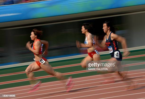 Tao Yujia of China wins her womens 100m heat in front of second place Fong Yee Pui of Hong Kong and third place Anna Doi of Japan during the East...