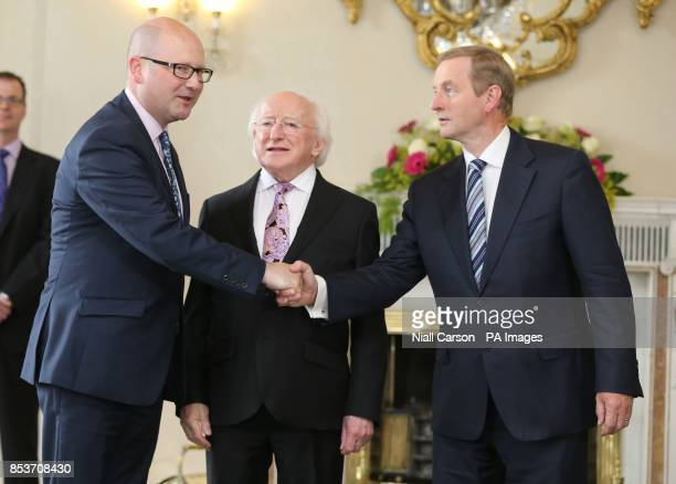 Taoiseach Enda Kenny and President Michael D Higgins congratulate Ged Nash on his appointment as a Junoir Minister in the Department of Jobs at Aras...