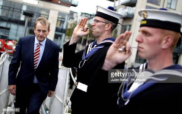 Taoiseach Enda Kenny is welcomed on board the Irish naval vessel LE Roisin by Seamen Kyle Fleming and Jason Green blowing the Bosun's Call during a...