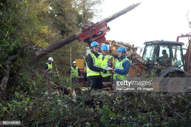 Taoiseach Leo Varadkar meets Pat O'Doherty and John McManus of ESB Networks in Kilcock Ireland as they clear fallen power lines after Hurricane...