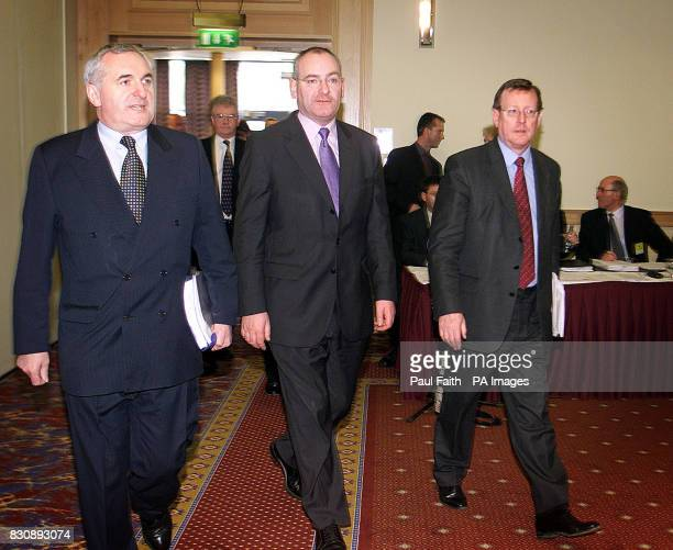 Taoiseach's Bertie Ahern Deputy First Minister Mark Durkan and First Minister David Trimble arrive at Armagh City Hotel for the fourth meeting of the...