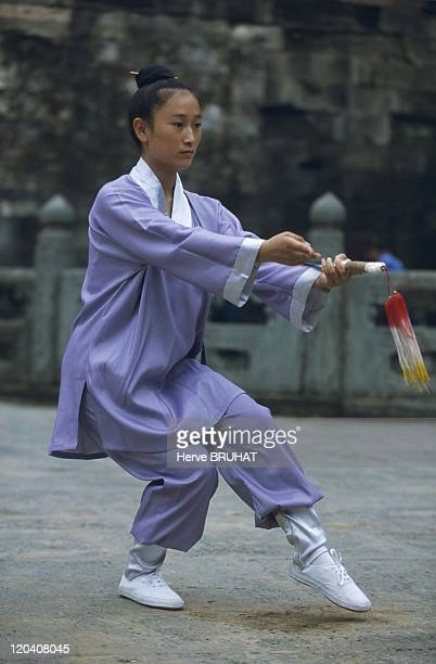 Taoism in China Temple of Purple Clouds Hubei province Mount Wudang Demonstration of Mount Wudang martial arts A young girl practiced tai chi sword A...