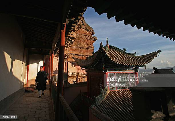 A Taoist nun walks at the Beichan Temple on October 14 2005 in Xining of Qinghai Province China Beichan Temple also known as North Hill Temple is one...