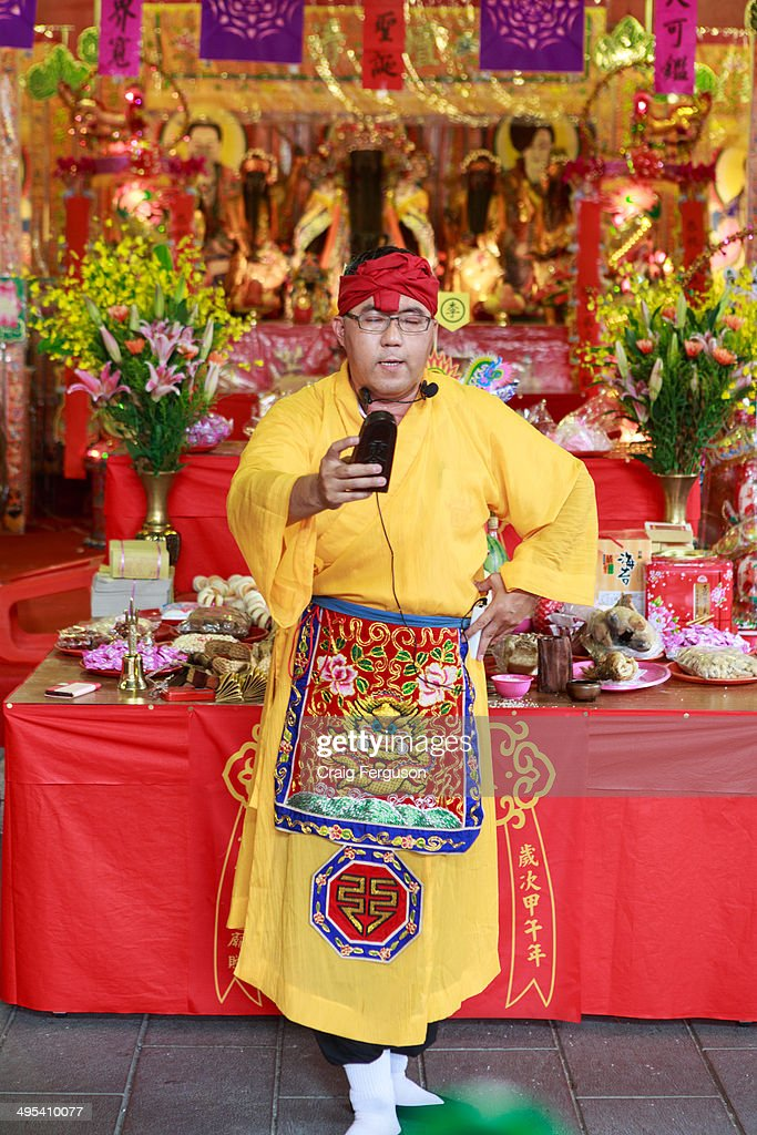 Taoist priest conducts prayers at the start of the Taipei City God birthday celebrations. The 160 year old temple holds an annual celebration every year during the 5th lunar month on the Chinese calendar.