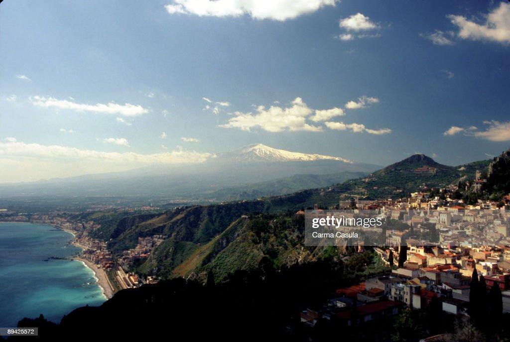 Taormina Catania Sicily Italy Panoramic of Taormina and the Mediterranean coast with Etna volcano like bottom drop curtain