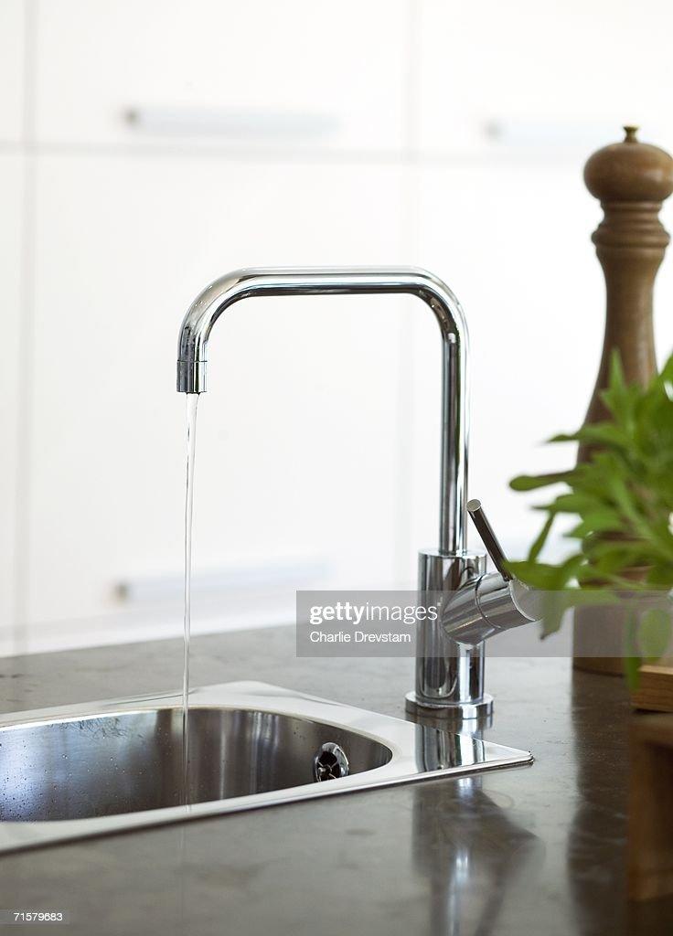 A tap in a sink.