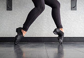 Young dancer in dance learning Toe Stands in tap shoes in Tap Class