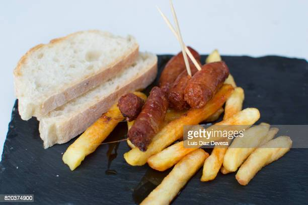 tapa of chorizo with fried potatoes