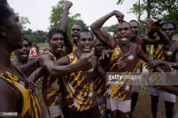 Tapalunga players celebrate during an Australian Rules football match at their local oval March 5 2007 on the Tiwi Island Australia Australian Rules...