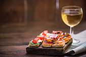 tapas and wine served on wooden rustic board