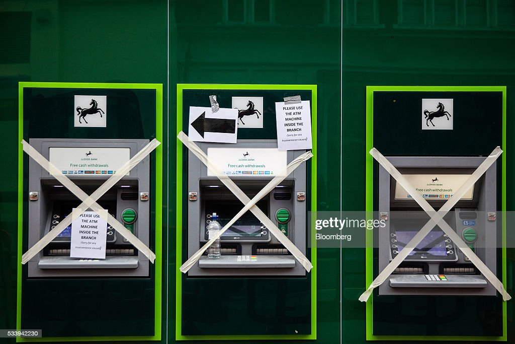 Tape covers the fronts of three out of use Lloyds Banking Group Plc automated teller machines (ATMs) on Oxford Street in central London, U.K., on Tuesday, May 24, 2016. U.K. retail sales began the second quarter with more momentum than economists forecast. Photographer: Simon Dawson/Bloomberg via Getty Images