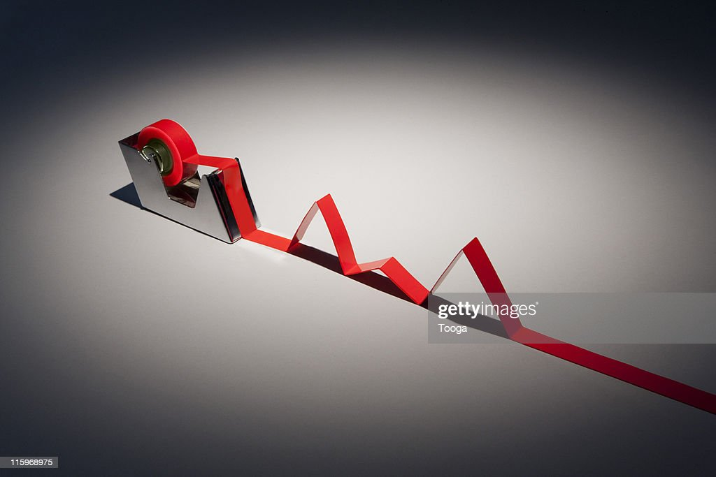 Tape dispenser with red tape growth chart : Stock Photo