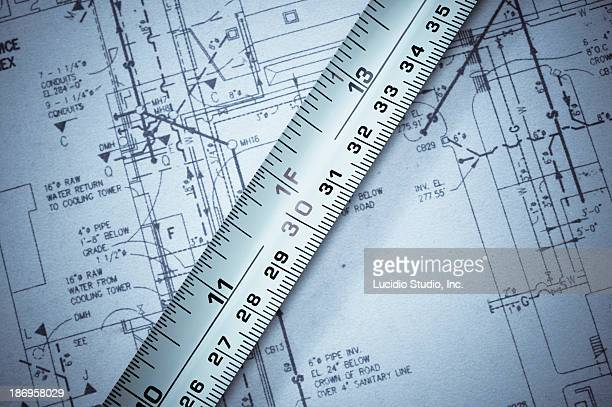 Tape measure against blueprints