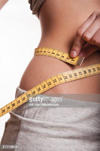 Tape measure around waist : ストックフォト
