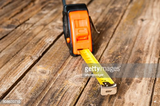 Tape measure closeup on wooden background : Stock Photo