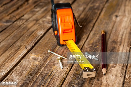 Tape measure on grunge wooden background : Stock Photo