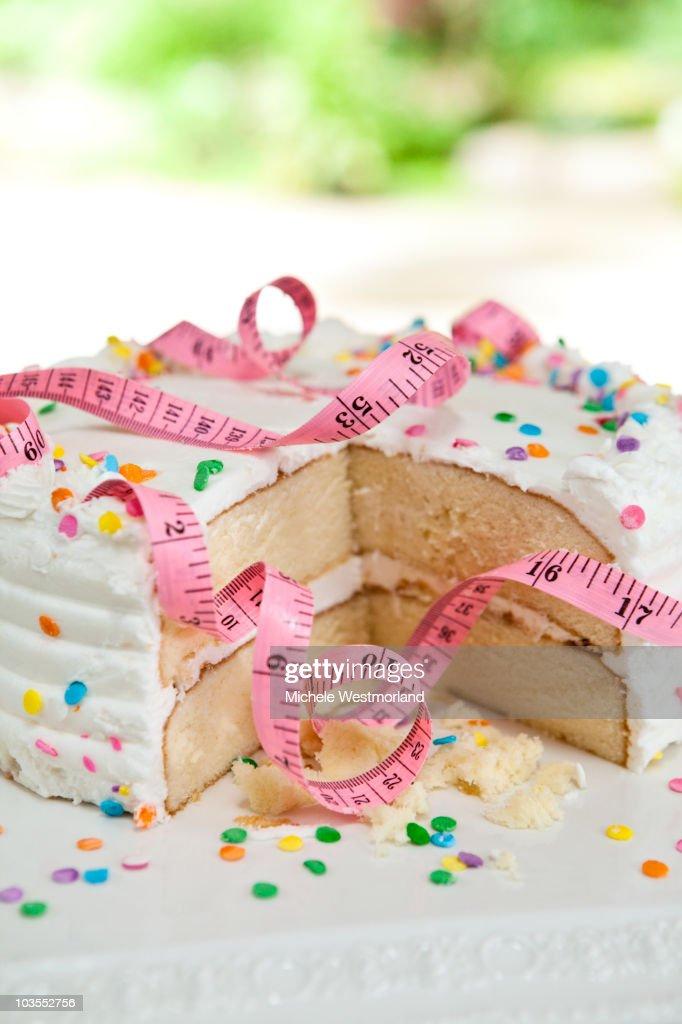 Tape Measure Wrapped Around Cake : Stock Photo