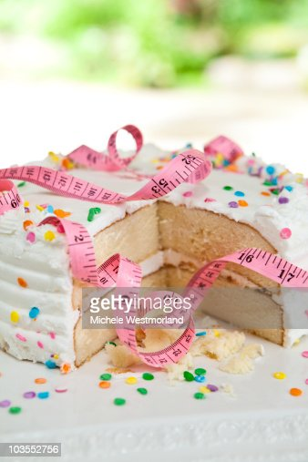 Tape Measure Wrapped Around Cake : Stock Photo