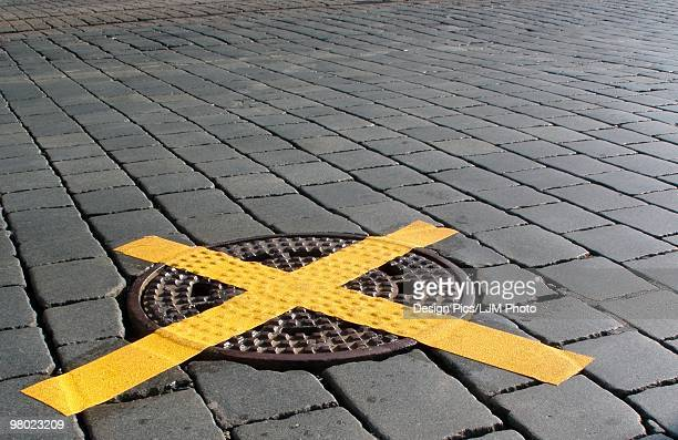 Tape over manhole