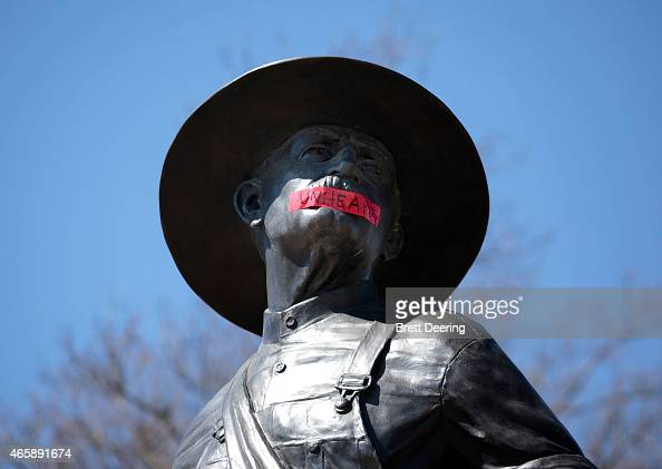 Tape with the word 'UNHEARD' covers the mouth of the sculpture 'The Sower' at the University of Oklahoma on March 11 2015 in Norman Oklahoma Video...