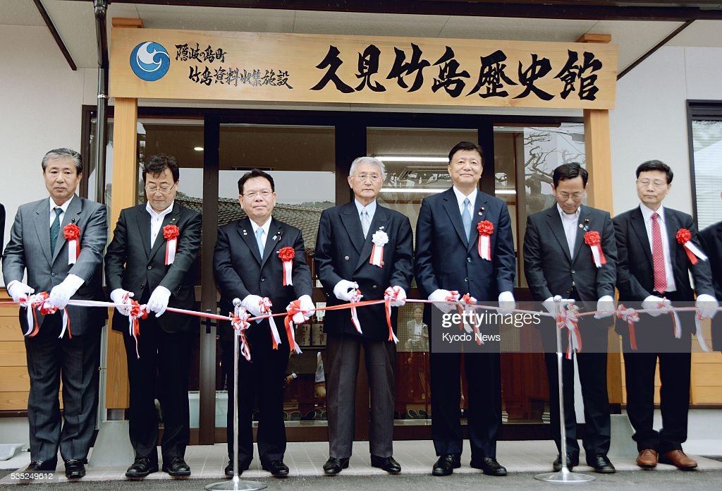 A tape-cutting ceremony is held in the western Japan town of Okinoshima on May 29, 2016, ahead of the June 1 opening of the Kumi Takeshima History Museum devoted to South Korea-controlled islets claimed by Japan. The Sea of Japan islets are called Dokdo in South Korea and Takeshima in Japan.