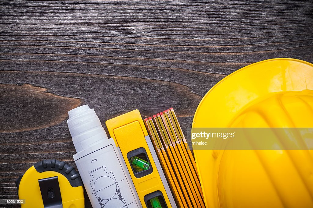 Tape-measure blueprints construction level building helmet and w : Stock Photo