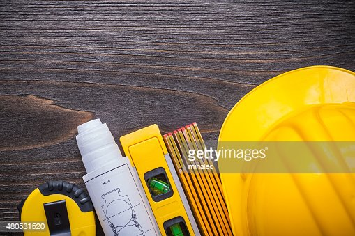 Tape-measure blueprints construction level building helmet and w : Stock Photo