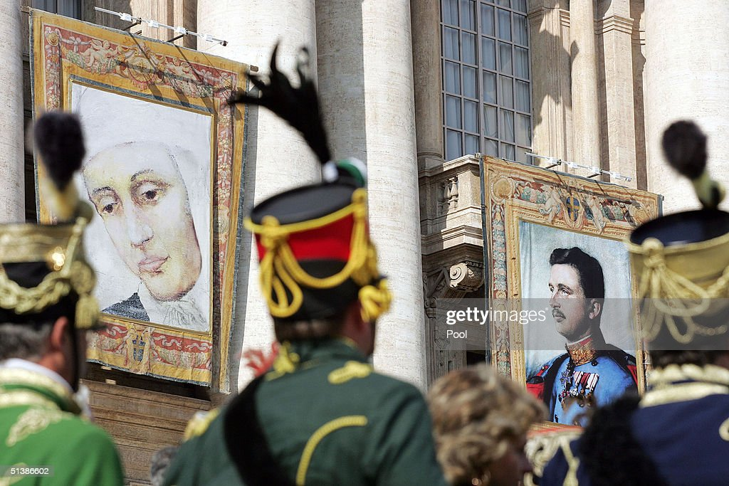 Tapestries featuring the portraits of beatified: (L) German mystic nun, Anna Katharina Emmerick, who inspired Mel Gibson's film, 'The Passion of The Christ' and Austria's last emperor, Karl I, hang on a balcony overlooking the altar in St. Peter's Square October 3 , 2004 in Vatican City. Pope John Paul II named five Catholics on the road to sainthood.