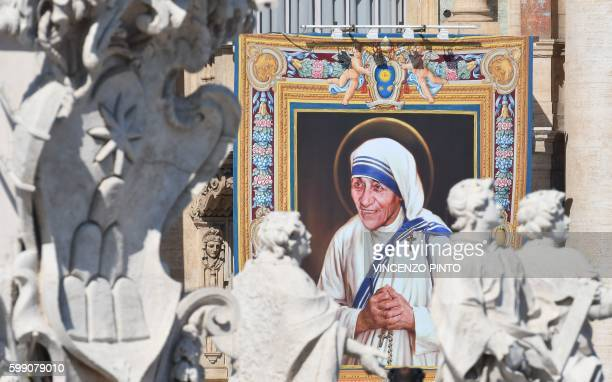 TOPSHOT A tapestry depicting Mother Teresa is seen on the facade of the Vatican building during the canonisation mass of Mother Teresa by Pope...