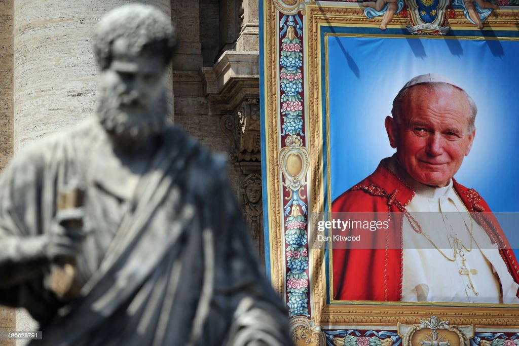 A tapestry depicting the late Pope John Paul II hangs on the balcony of St Peter's basilica on April 25, 2014 in Vatican City, Vatican. The late Pope John Paul II and Pope John XXIII will be canonised on Sunday 27 April, inside the Vatican when 800,000 pilgrims from around the world are expected to attend.