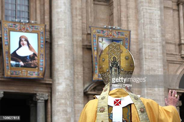 Tapestry featuring the portrait of Australia's first Saint Sister Mary MacKillo is draped from the balcony overlooking St Peter's Square as Pope...