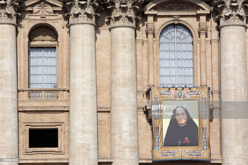 Tapestry featuring the portrait of new appointed Saint Mexican Maria Guadalupe Garcia Zavala is draped from the balcony overlooking St. Peter's Square as Pope Francis attends a canonization ceremony on May 12, 2013 in Vatican City, Vatican. The pontiff today canonized over 800 new saints; Antonio Primaldo and his companions, martyrs of Otranto in Italy; first Colombian Saint in history Laura di Santa Caterina da Siena Montoya y Upegui, virgin and foundress; and the Mexican Maria Guadalupe Garcia Zavala, co-foundress.