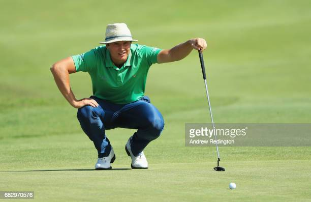 Tapio Pulkkanen of Finland lines up a putt on the 18th green during the final round on day four of the Open de Portugal at Morgado Golf Resort on May...