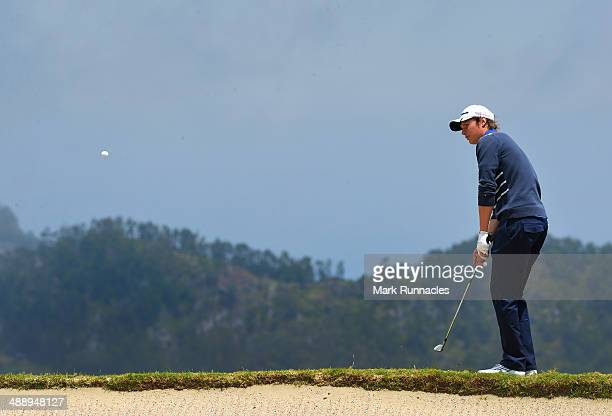 Tapio Pulkkanen of Finland plays a chip shot after over shooting the 4th green during the Madeira Islands Open Portugal BPI at Club de Golf do Santo...