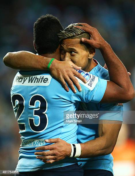 Taqele Naiyaravoro and Israel Folau of the Waratahs embrace after Naiyaravoro scored a try during the round 18 Super Rugby match between the Waratahs...