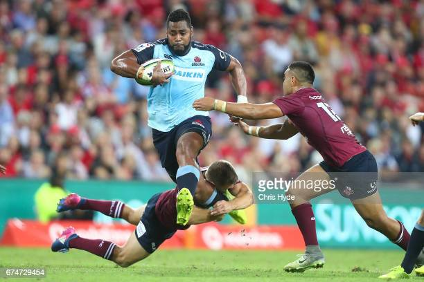 Taqele Naiyaravoro of the Waratahs is tackled during the round 10 Super Rugby match between the Reds and the Waratahs at Suncorp Stadium on April 29...