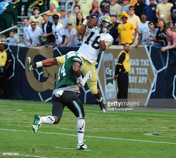 TaQuon Marshall of the Georgia Tech Yellow Jackets makes a catch for a touchdown against Malik Eugene of the Tulane Green Wave on September 12 2015...