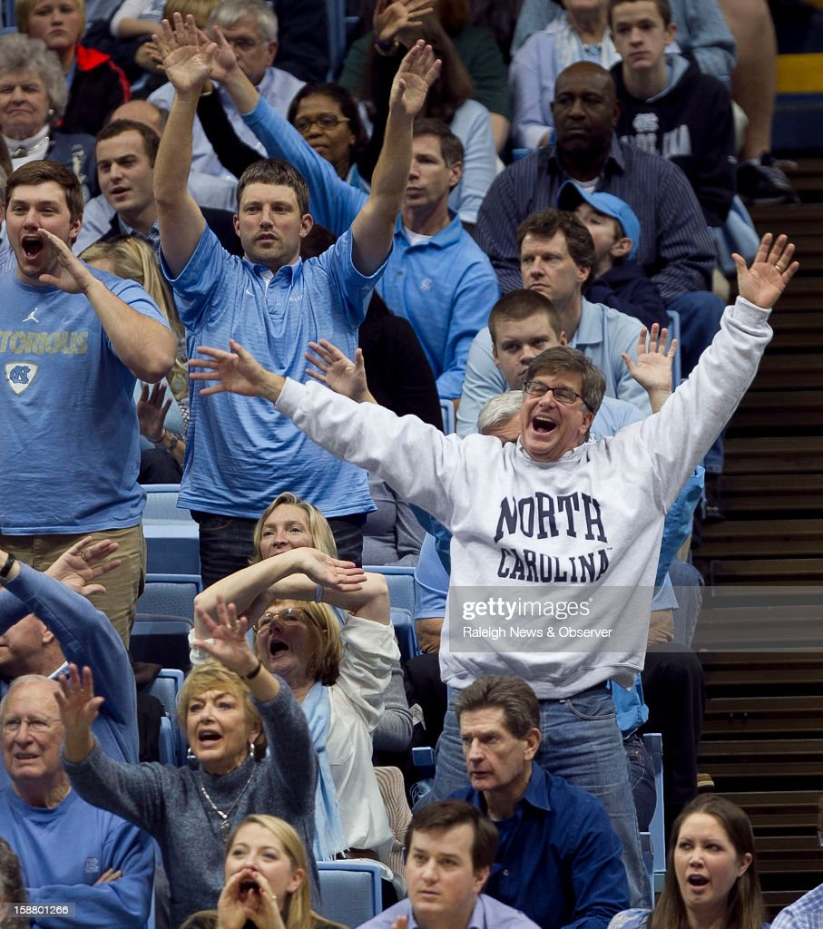 Tar Heel fans harass a UNLV shooter at the free throw line late in the second half at the Smith Center in Chapel Hill, North Carolina, Saturday, December 29, 2012. UNC defeated UNLV, 79-73.
