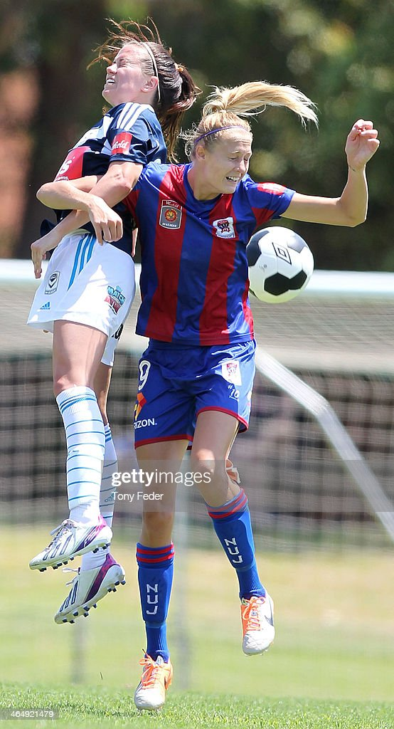 Tara Andrews of the Jets contests a header with her Victory opponent during the round 10 W-League match between the Newcastle Jets and Melbourne Victory at Adamstown Oval on January 25, 2014 in Newcastle, Australia.