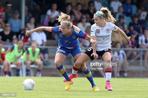 Tara Andrews of the Jets contests the ball with Ellie Carpenter of the Wanderers during the round four WLeague match between the Newcastle Jets and...