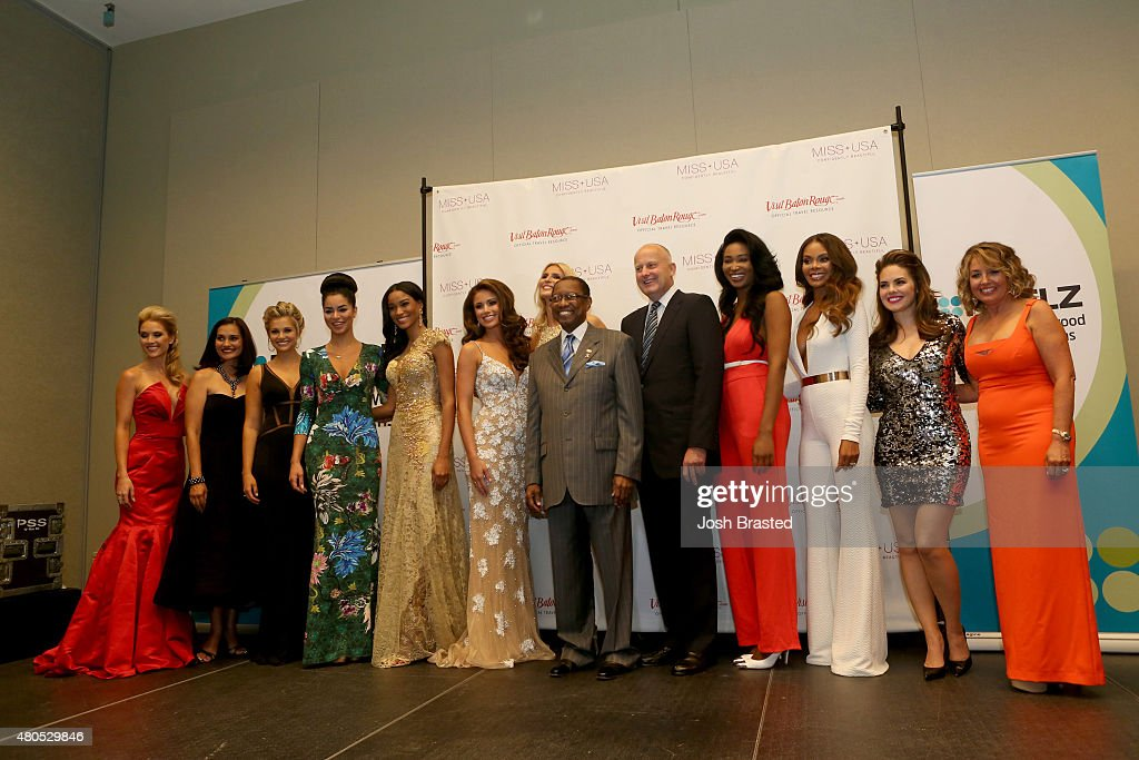 Tara Conner, Brook Lee, Danielle Doty, Rima Fakih, Leila Umenyiora, Nia Sanchez, Michelle McLean-Bailey, Mayor- President of Baton Rouge Melvin 'Kip' Holden, REELZChannel CEO Stan E. Hubbard, Nana Meriwether, Crystle Stewart, Kimberly Pressler, and President of the Miss Universe Organization Paula M. Shugart pose on stage during the 2015 Miss USA Pageant Only On ReelzChannel Press Conference at The Baton Rouge River Center on July 12, 2015 in Baton Rouge, Louisiana.