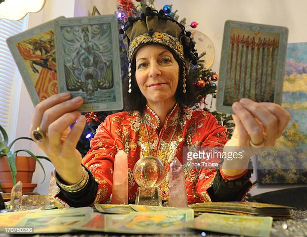 Tara Greene holds up 3 tarot cards that she chose when the question what will come of Mayor Rob Ford in 2013 came up From left to right The first...