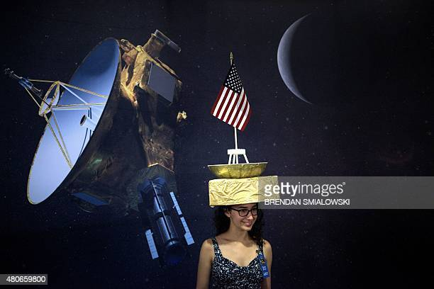 Tara Kedia poses wearing a New Horizons probe hat at the Johns Hopkins University Applied Physics Laboratory July 14 2015 in Laurel Maryland The...
