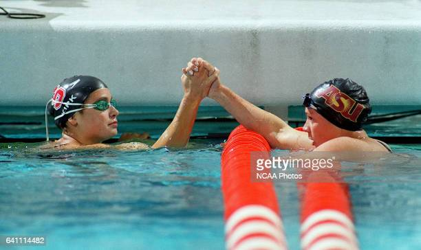 Tara Kirk of Standford University and Agnes Kovacs of Arizona State University give each other a highfive following the Women's 200 Yard Breaststroke...