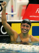 Tara Kirk of the United States of America celebrates winning the the Womens 100m Breastroke during the Duel in the Pool swimming meet between...