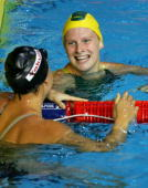 Tara Kirk of the United States of America congratulates Leisel Jones of Australia following the Women's 100m Breaststroke final during the XII FINA...