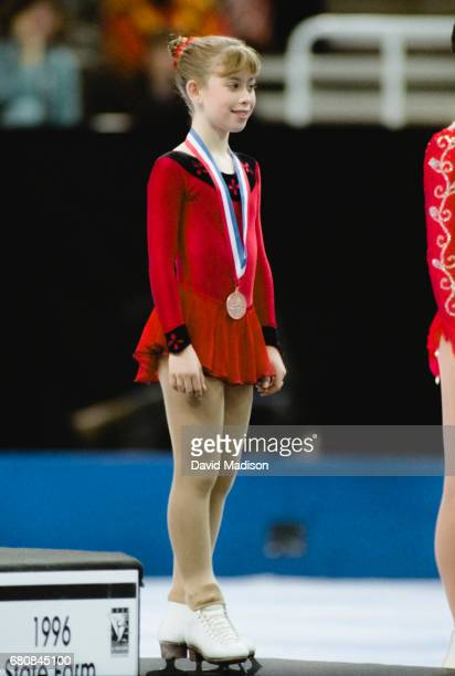 Tara Lipinski of the USA participates in the awards ceremony for the Ladies' Singles competition of the 1996 United States Figure Skating...